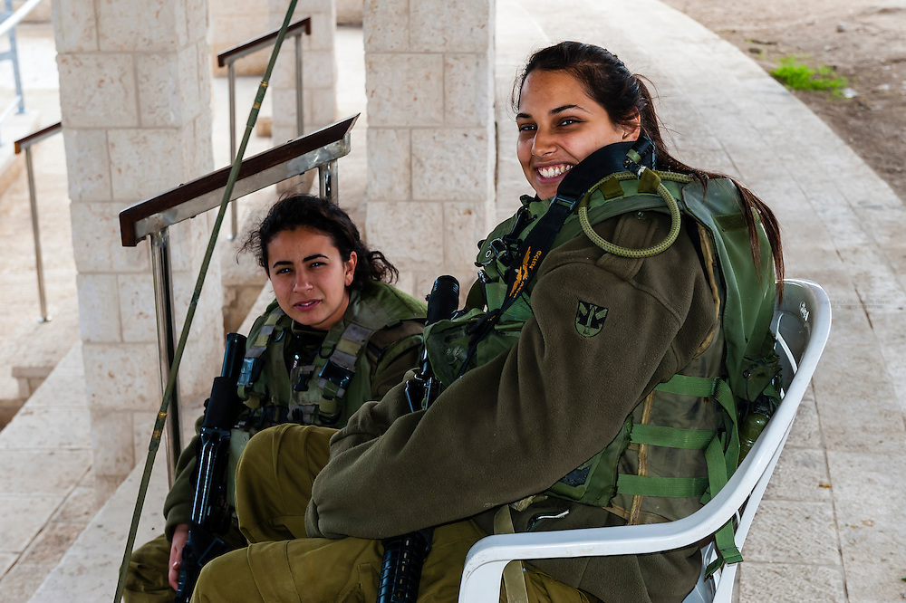 Female Israeli soldiers guading the frontier with Jordan at Qasr-Al-Yahud on the River Jordan (where Jesus was baptized by John the Baptist), Israel.