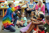 Scienceteller Taylor Darden (left) tells a story during the Sciencetellers show Thursday July 23, 2015 at the Union Library in Hatboro, Pennsylvania. Sciencetellers teach science to their audience by telling a lively, interactive and exciting story intertwined with basic science principles. (Photo by William Thomas Cain)