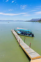 Moored boats, lake front, Chapala, Jalisco, Mexico. Lake Chapala is the largest body of freshwater in Mexico. Photo: Peter Llewellyn