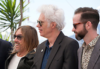 Iggy Pop, Director Jim Jarmusch and Carter Logan at the Gimme Danger film photo call at the 69th Cannes Film Festival Thursday 19th May 2016, Cannes, France. Photography: Doreen Kennedy