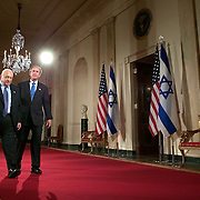 Pres. Bush and the Prime Minister of Israel Ariel Sharon hold a joint news conference in the Cross Hall of the White House Wednesday, April 14, 2004, in Washington.  Bush accepted the prime minister's proposed withdraw of Israel from the West Bank and Gaza Strip, a move intended to diffuse tensions in the region and return Israel to its original 1949 borders...Photo by Khue Bui