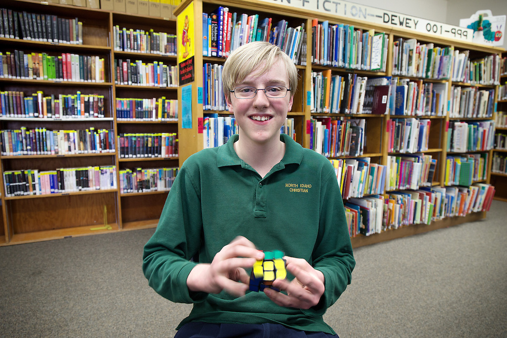 GABE GREEN/Press<br /> <br /> Preston Pfau swiftly solves a speed cube Wednesday. The North Idaho Christian School seventh-grader will be competing in the North Idaho Regional Spelling Bee for the second year in a row.
