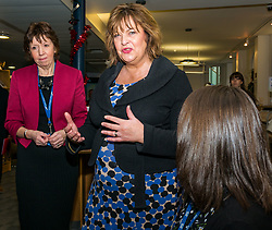 Pictured: Scottish Government Public Libraries Funding Announcement. Culture Minister Fiona Hyslop announces this year's successful bids to the £450,000 Public Library Improvement Fund (PLIF) at the John Grey Centre, Haddington Library, Haddington, East Lothian, Scotland, United Kingdom.  PLIF has been supporting innovative library projects since 2006 which help both individuals and communities. Fiona Hyslop and hte Depute Chief Executive of East Lothian Council,  Monica Patterson. A member of staff demonstrates the use of Boardmaker for children with communication difficulties. Pictured L to R: Depute Chief Executive of East Lothian Council,  Monica Patterson. and Fiona Hyslop. 13 December 2018  <br /> <br /> Sally Anderson | EdinburghElitemedia.co.uk
