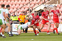11th November 2018 , Racecourse Ground,  Wrexham, Wales ;  Rugby League World Cup Qualifier,Wales v Ireland ; Steve Parry of Wales is tackled by Declan O'Donnell of Ireland <br /> <br /> <br /> Credit:   Craig Thomas/Replay Images