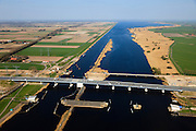 Nederland, Flevoland-Overijssel, Ramspol, 01-05-2013; nieuwe Ramspolbrug in de N50 gezien in oostelijke richting met voor de brug de balgstuw, links Flevoland, rechts Overijssel.  De vaargeul in het Ramsdiep met strekdam. Ramspol, inflatable dike, between Ketelmeer and Black Water. The Balgstuw (bellow barrier) is a storm barrier and consists of an inflatable dam or dyke, composed of three bellows. Usually, each bellow rests on the bottom of the water, but now the bellows are inflated  because of maintenance. luchtfoto (toeslag op standard tarieven)<br /> aerial photo (additional fee required)<br /> copyright foto/photo Siebe Swart<br /> luchtfoto (toeslag op standard tarieven)<br /> aerial photo (additional fee required)<br /> copyright foto/photo Siebe Swart