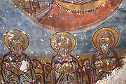 Fresco, detail, in Yilanli Kilise or St George's Church, known as Snake Church, originally part of a monastery, at the Goreme Open Air Museum, in Goreme, in Nevsehir province, Cappadocia, Central Anatolia, Turkey. The church has a simple low barrel-vaulted nave and many frescoes, including St Theodore and St George slaying the dragon, which is depicted as a snake. The churches in Goreme are carved from the soft volcanic tuff created by ash from volcanic eruptions millions of years ago. Early christians came here to flee persecution by the Romans and others settled here under the influence of early saints. This area forms part of the Goreme National Park and the Rock Sites of Cappadocia UNESCO World Heritage Site. Picture by Manuel Cohen