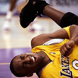 Lakers Kobe Bryant ,8, goes down hard in the 4th quarter. Golden State Warriors vs Los Angeles Lakers at the Staples Center in Los Angeles  January 27. 2006. Lakers beat the Warriors in OT 106-105.