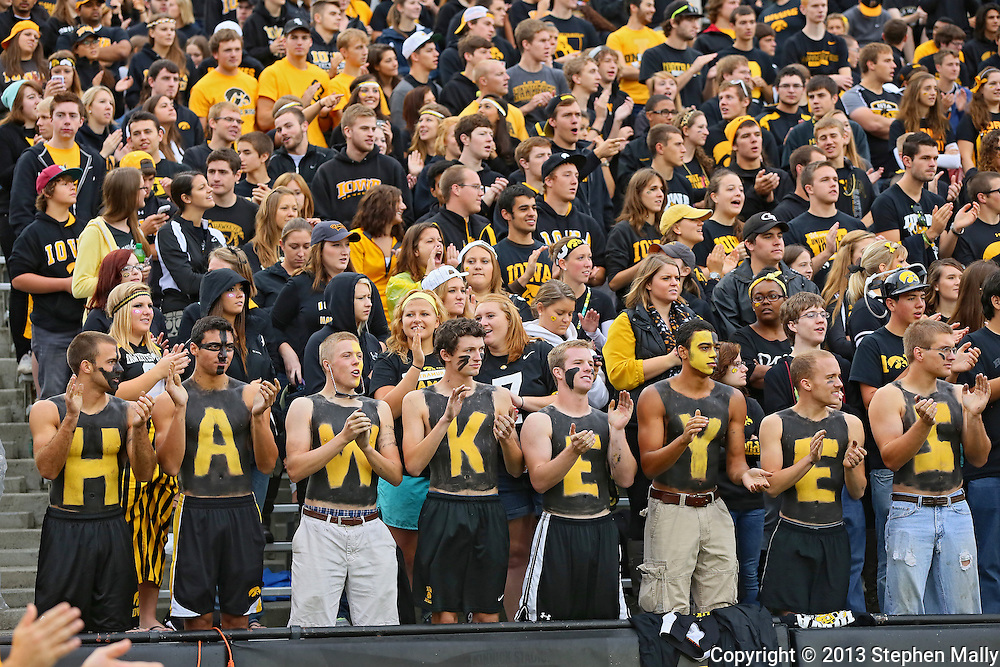 October 6 2013: Fans in the Iowa Hawkeyes student section cheer before the start of the NCAA football game between the Michigan State Spartans and the Iowa Hawkeyes at Kinnick Stadium in Iowa City, Iowa on October 6, 2013. Michigan State defeated Iowa 26-14.