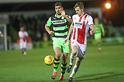 Forest Green Rovers Omar Bugiel(11) and Cheltenham Town's William Boyle(15) challenge for the ball during the EFL Sky Bet League 2 match between Forest Green Rovers and Cheltenham Town at the New Lawn, Forest Green, United Kingdom on 25 November 2017. Photo by Shane Healey.