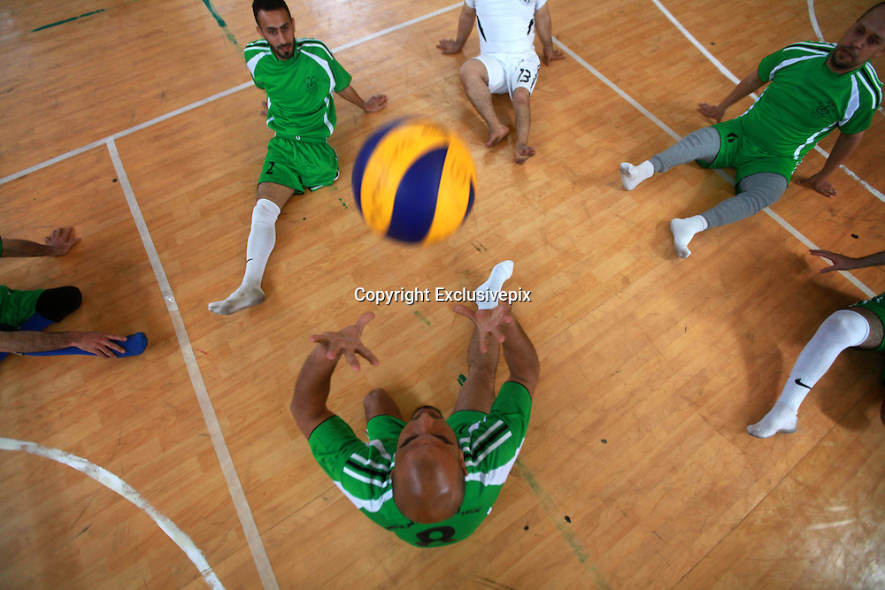 May 7, 2014 - Gaza City, Gaza Strip - <br /> <br /> Palestinian Amputees Play Volleyball<br /> <br /> Disabled Palestinian volleyball players take part in a game in Gaza City. <br /> ©Exclusivepix