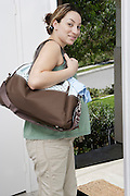 Pregnant woman exiting house