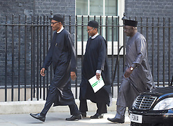 © Licensed to London News Pictures. 23/05/2015. London, UK. President of Nigeria, General Muhammadu Buhari, left, arrives at 10 Downing Street, central London, to meet British Prime Minister David Cameron. Photo credit : Isabel Infantes/LNP