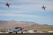 RENO, NV - SEPTEMBER 13: Jets fly over a WWII airplane near the runway at the Reno Championship Air Races on September 13, 2017 in Reno, Nevada. (Photo by Jonathan Devich/Getty Images)