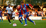 Dwight Gayle on the attack during the Pre-Season Friendly match between Bromley and Crystal Palace at the Courage Stadium, Bromley, United Kingdom on 30 July 2015. Photo by Michael Hulf.
