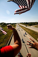Residents of Dousman Wis. show their appreciation as thousands of Harley Davidson bikers arrive Wednesday Aug. 27, 2003 Dousman WI. Thousands of Harley Davidson bikers from all over the world came to Wisconsin to help celebrate Harley Davidson 100th anniversary.   photo by Darren Hauck