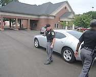 Oxford police chief Mike Martin talks on the radio following a robbery of the Mississippi Federal Credit Union on West Jackson Avenue in Oxford, Miss. on Wednesday, June 30, 2010.