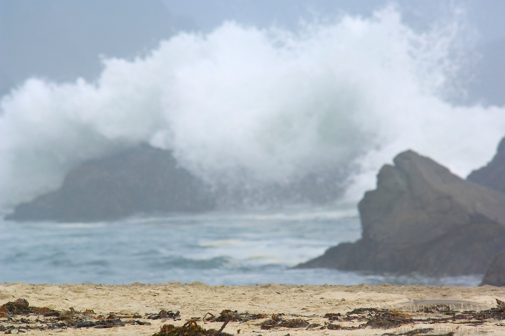 Ocean waves breaking over rocks along Pfeiffer Beach, Big Sur Coast, Monterey County, California