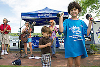 "With the band playing ""Send Me On My Way"" Greyson Rule and Makenna Bowen from Merrimack join in the fun at Hesky Park during the Make A Wish event on Saturday afternoon.  Makenna's wish of going to Disney will be granted in October.   (Karen Bobotas/for the Laconia Daily Sun)"