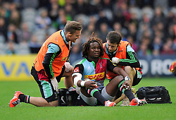 Marland Yarde of Harlequins is treated after taking a knock during the match - Photo mandatory by-line: Patrick Khachfe/JMP - Mobile: 07966 386802 04/10/2014 - SPORT - RUGBY UNION - London - The Twickenham Stoop - Harlequins v London Welsh - Aviva Premiership