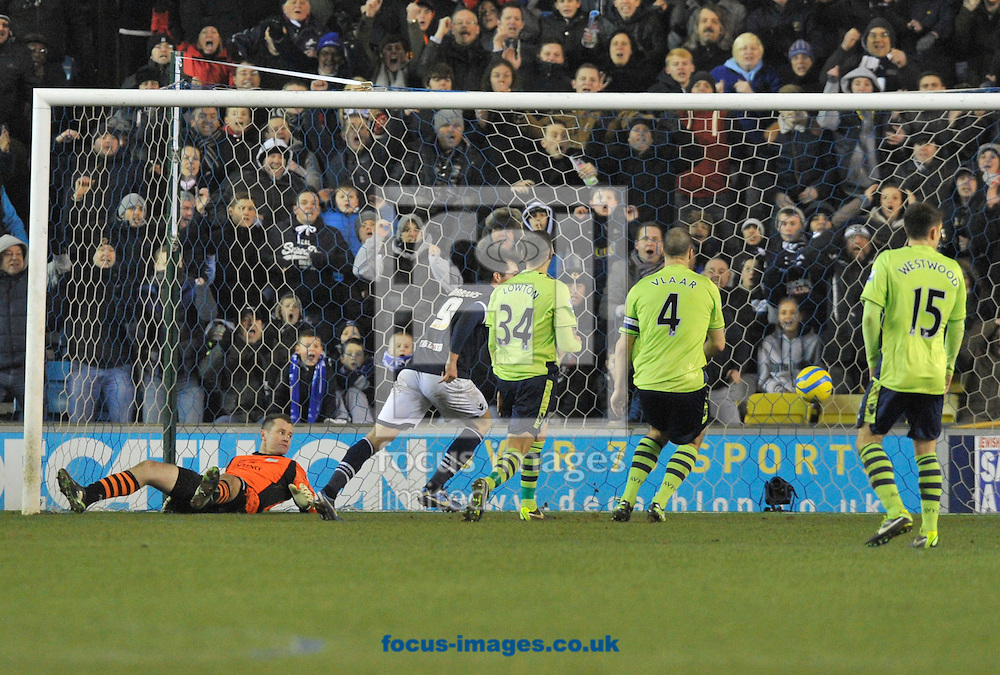 Picture by Alan Stanford/Focus Images Ltd +44 7915 056117.25/01/2013.John Marquis of Millwall  puts the ball past goalkeeper Shay Given of Aston Villa to get a late winner in the The FA Cup match at The Den, London.