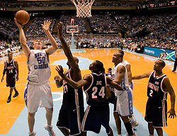 UNC's Tyler Hansbrough (50) prepares a shot over UVA's Tunji Soroye (21).  Hanbrough had a game high 18 points as the #1 ranked Tar Heels beat the Cavaliers 79-69 to improved to 15-1 overall, 2-0 ACC on January 10, 2007 at the Dean Smith Center in Chapel Hill, NC.<br />