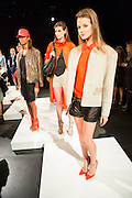 Three models pose on platforms. The show allowed guests to circulate around stationary models.  By Monika Chiang at Spring 2013 Fashion Week in New York.