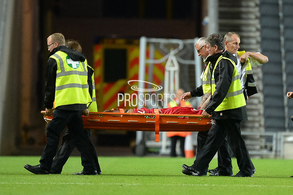 Swansea City defender Kyle Bartley (27) is stretchered off during the EFL Cup match between Milton Keynes Dons and Swansea City at stadium:mk, Milton Keynes, England on 22 August 2017. Photo by Dennis Goodwin.