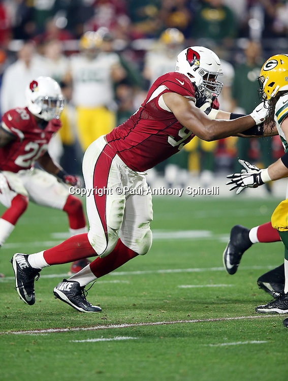 Arizona Cardinals defensive end Calais Campbell (93) works his way around a block as he chases the action during the NFL NFC Divisional round playoff football game against the Green Bay Packers on Saturday, Jan. 16, 2016 in Glendale, Ariz. The Cardinals won the game in overtime 26-20. (©Paul Anthony Spinelli)
