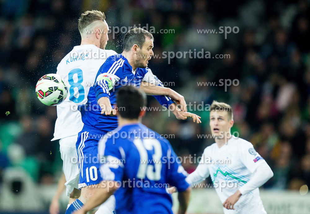 Jasmin Kurtic of Slovenia vs Andy Selva of San Marino during football match between NationalTeams of Slovenia and San Marino in Round 5 of EURO 2016 Qualifications, on March 27, 2015 in SRC Stozice, Ljubljana, Slovenia. Photo by Vid Ponikvar / Sportida