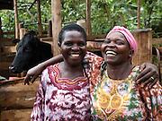 Edith Wogisha and her peer farmer Beatrice Vlodeya.