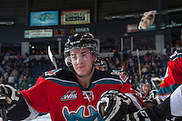 KELOWNA, CANADA - DECEMBER 6: Riley Stadel #3 of the Kelowna Rockets celebrates the first goal by Ryan Olsen #27 against the Everett Silvertips setting off the annual teddy bear toss on December 6, 2013 at Prospera Place in Kelowna, British Columbia, Canada.   (Photo by Marissa Baecker/Shoot the Breeze)  ***  Local Caption  ***