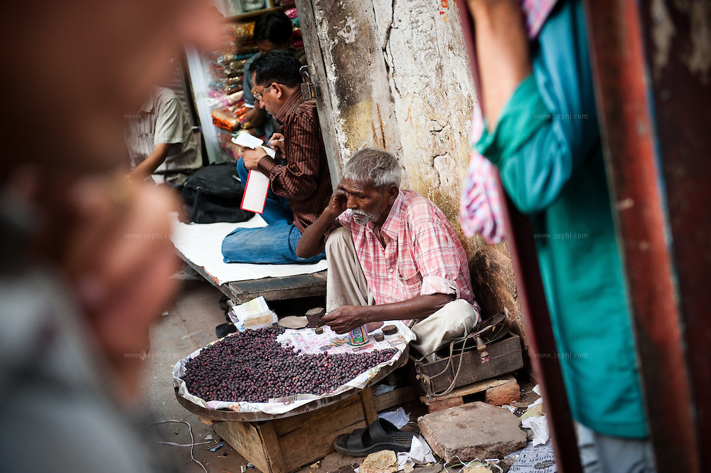 A vendor selling berries (Falsa) in Old Delhi
