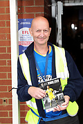Program seller during the EFL Sky Bet League 1 match between AFC Wimbledon and Gillingham at the Cherry Red Records Stadium, Kingston, England on 12 September 2017. Photo by Matthew Redman.