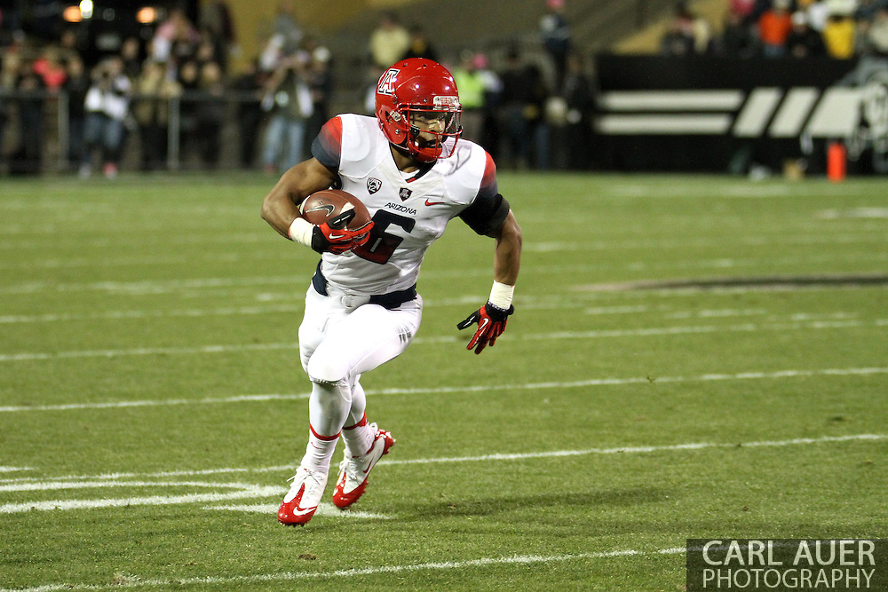October 26th, 2013:  University of Arizona Wildcats freshman wide receiver Nate Phillips (6) brings the ball towards the sideline in the first quarter of the NCAA football game between the University of Arizona Wildcats and the University of Colorado Buffaloes at Folsom Field in Boulder, Colorado