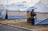 A tent city was set up by the United Nations High Commissioner for Refugees in gas station, that arriving by bus from Athens near Greece - Macedonian border, 8 Febraury 2016. Hundreds of refugees  wait every day at a gas station used as a temporary camp outside of Polykastro city at the north part of Greece until they receive the order from the police to move to the Greece- Macedonian border and continue their trip  to North Europe.