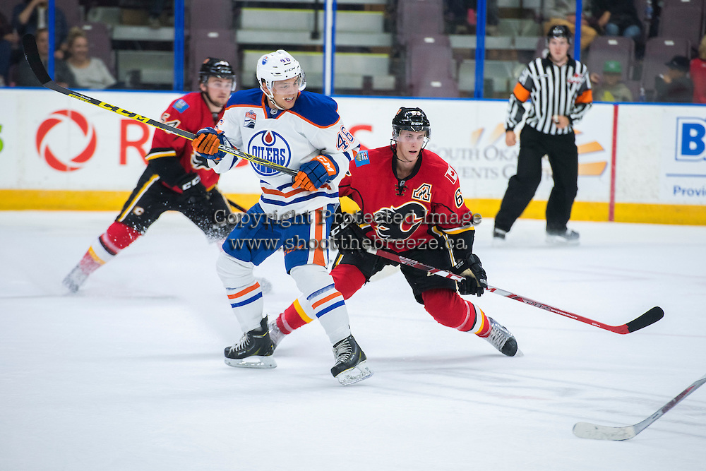 PENTICTON, CANADA - SEPTEMBER 17:  Tyler Vesel #46 of the Edmonton Oilers is back checked by Ryan Culkin #63 of Calgary Flames on September 17, 2016 at the South Okanagan Event Centre in Penticton, British Columbia, Canada.  (Photo by Marissa Baecker/Shoot the Breeze)  *** Local Caption *** Tyler Vesel; Ryan Culkin;