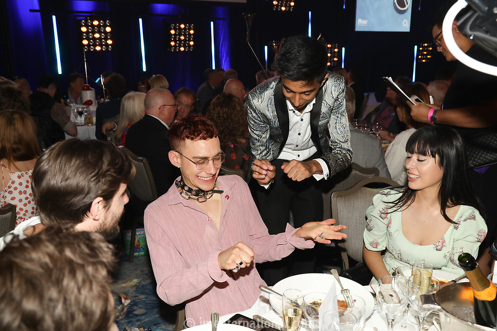 Years and Years enjoy magic trick during the O2 Silver Clef Awards 2019, Grosvenor House, London, UK, Friday 05 July 2019<br /> Photo JM Enternational
