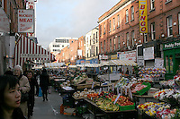 Moore Street in Dublin Ireland local outdoor market selling flowers fruit and vegetables