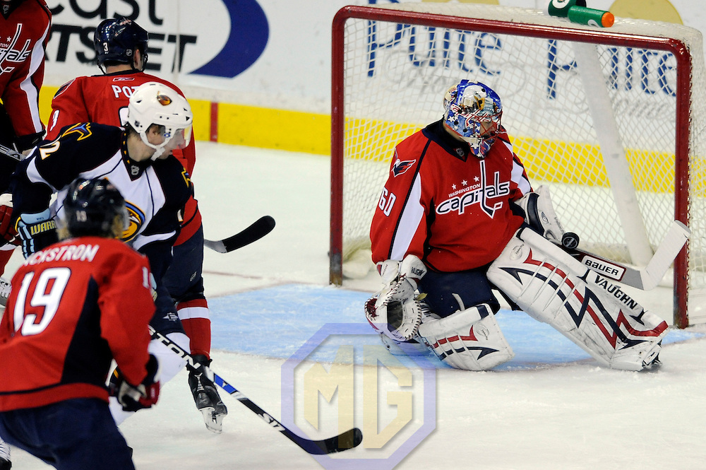 05 April 2009:  Washington Capitals goalie Jose Theodore (60) makes a save on a shot in the 1st period by Atlanta Thrashers center Todd White (12) at the Verizon Center in Washington, D.C.  The Capitals defeated the Thrashers 6-4.
