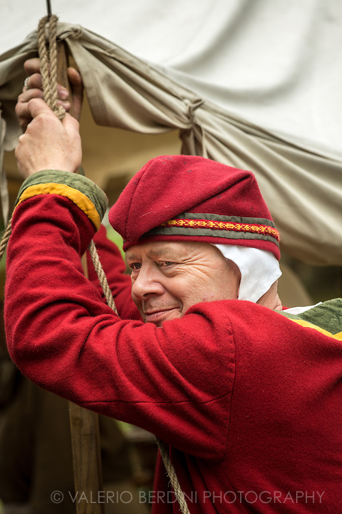 A man gets ready to support the attack. It's been 950 years since King Harold got an arrow in the eye at the Battle of Hastings. A group of re-enactors set up a camp near Apsley House in Hyde Park, London, to show their weapons, games and living arrangements.