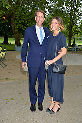 BEN ELLIOT and his wife MARY CLARE ELLIOT at a dinner hosted by Cartier in celebration of The Chelsea Flower Show held at The Hurligham Club, London on 19th May 2014.
