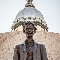 Picture of Abraham Lincoln Statue at Illinois State Capitol in Springfield, Illinois. The Abraham Lincoln statue is bronze and was created by sculptor Andrew O'Connor. The statue was dedicated in 1918.