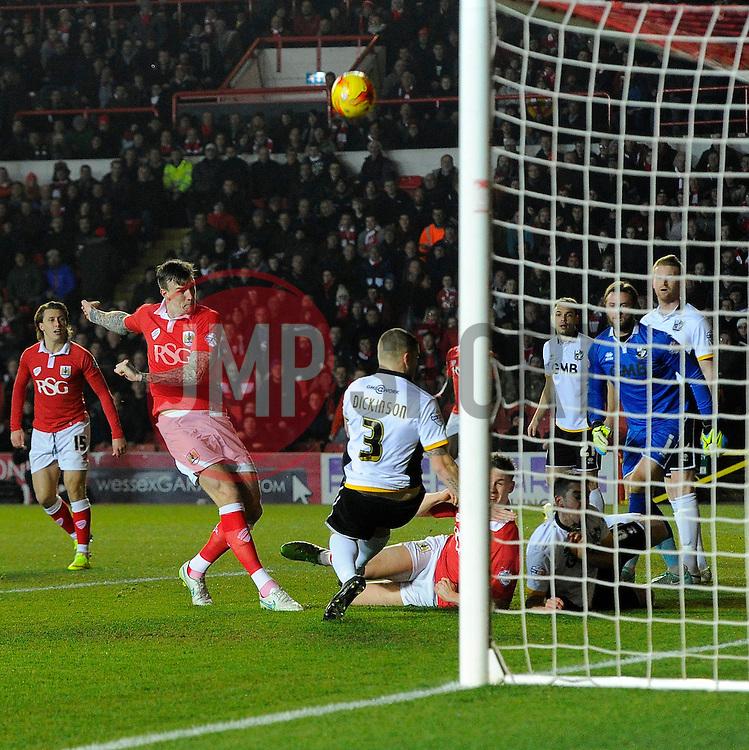 Bristol City's Aden Flint sees his shot blocked by Port Vale's Carl Dickinson  - Photo mandatory by-line: Joe Meredith/JMP - Mobile: 07966 386802 - 10/02/2015 - SPORT - Football - Bristol - Ashton Gate - Bristol City v Port Vale - Sky Bet League One