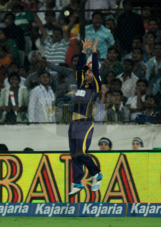 Ryan Ten Doeschate of Kolkata Knight Riders attempts a catch during match 10 of the Oppo Champions League Twenty20 between the Kolkata Knight Riders and the Perth Scorchers held at the Rajiv Gandhi Cricket Stadium, Hyderabad, India on the 24th September 2014<br /> <br /> Photo by:  Pal Pillai / Sportzpics/ CLT20<br /> <br /> <br /> Image use is subject to the terms and conditions as laid out by the BCCI/ CLT20.  The terms and conditions can be downloaded here:<br /> <br /> http://sportzpics.photoshelter.com/gallery/CLT20-Image-Terms-and-Conditions-2014/G0000IfNJn535VPU/C0000QhhKadWcjYs