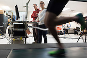 Dr. Peter Weyland and Dr. Lindsay Ludlow look on as Ryan Hall runs on the treadmill at the SMU Locomotor Performance Lab in Dallas, Texas on March 18, 2016. (Cooper Neill for The New York Times)