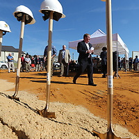 Tupelo Mayor Jason Shelton leads the group of officials to the shovels to break ground on the new Fairpark Towers in Tupelo Thursday morning.