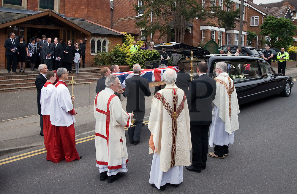 © licensed to London News Pictures. 18/05/2011. Tonbridge, UK. The coffin of heavyweight boxing legend Sir Henry Cooper leaving Corpus Christi Church in Lyons Crescent, Tonbridge, Kent today (18/05/2011).  Please see special instructions for usage rates. Photo credit should read Ben Cawthra/LNP