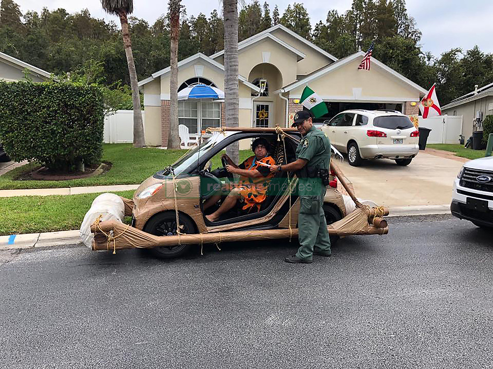 """A Florida man was apprehended by cops in a mock arrest for """"speeding"""" in his Fred Flintstone car. Deputies from Pasco County Sheriff's Department detained Don Swartz when he was spotted in his modified Smart Car in Wesley Chapel, Florida. Cops then staged a mock arrest of Swartz claiming he was speeding and being """"unruly"""". Photos released by the sheriff's office show Swartz, who was dressed up as Fred, driving a Smart car decked out to look like the Flintstones' famous leg-powered vehicle. In a post, the sheriff's office said: """"Mr Flintstone was issued a citation for speed and became unruly and had to be detained. After further investigation, Mr Flintstone was issued a Notice To Appear and released. Deputy Echevarria then seized the vehicle which is now part of the PSO fleet. This is what Intelligence-Led Policing looked like in the stone age."""". 14 Nov 2018 Pictured: Don Swartz and his Flintstone car. Photo credit: MEGA TheMegaAgency.com +1 888 505 6342"""