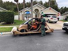 "Florida man turns his smart car into a Flintstone-mobile and gets ""arrested"" - 14 Nov 2018"