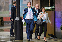 © Licensed to London News Pictures. 01/10/2017. Manchester, UK. GAVIN BARWELL (centre), chief of staff to Theresa May and JONNNA PENN (right) deputy chief of staff to Theresa May, seen on the opening day of the Conservative Party Conference. There have been conflicts within the conservative party and government over the UK's approach to Brexit, which is expected to feature heavily at this years event. Photo credit: Ben Cawthra/LNP